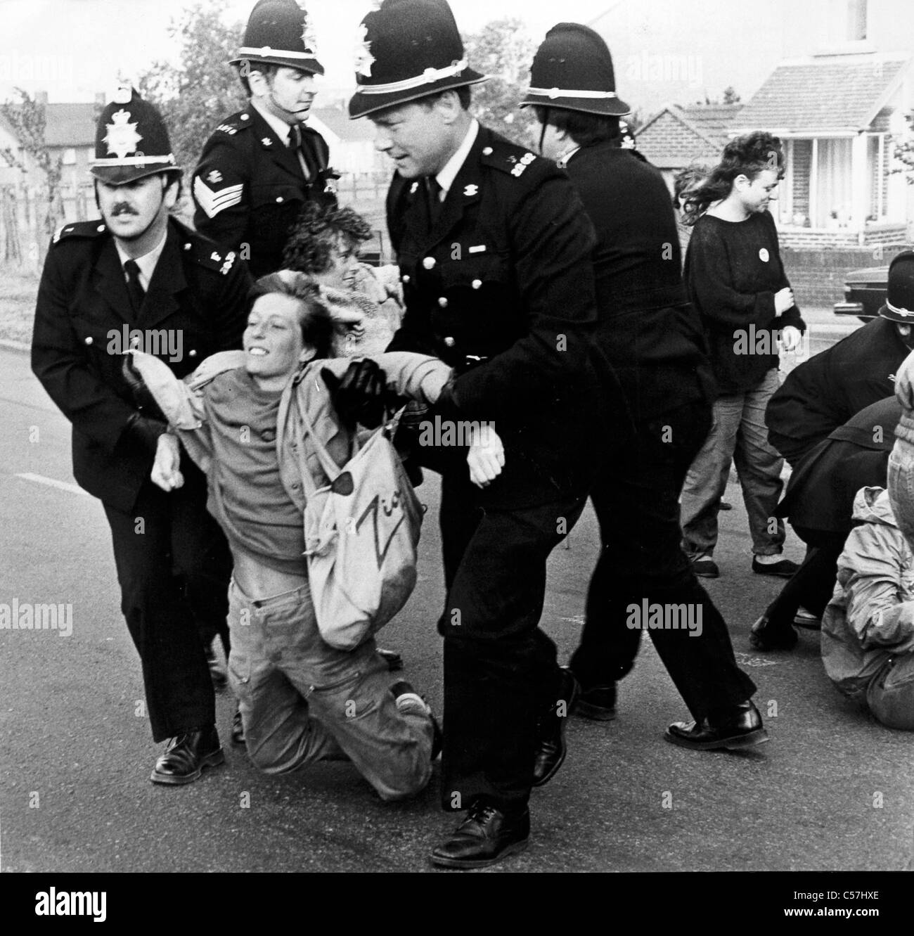 Female protesters backing the picketing miners are forcibly removed by Police at Port Talbot Steelworks. (4th July Stock Photo
