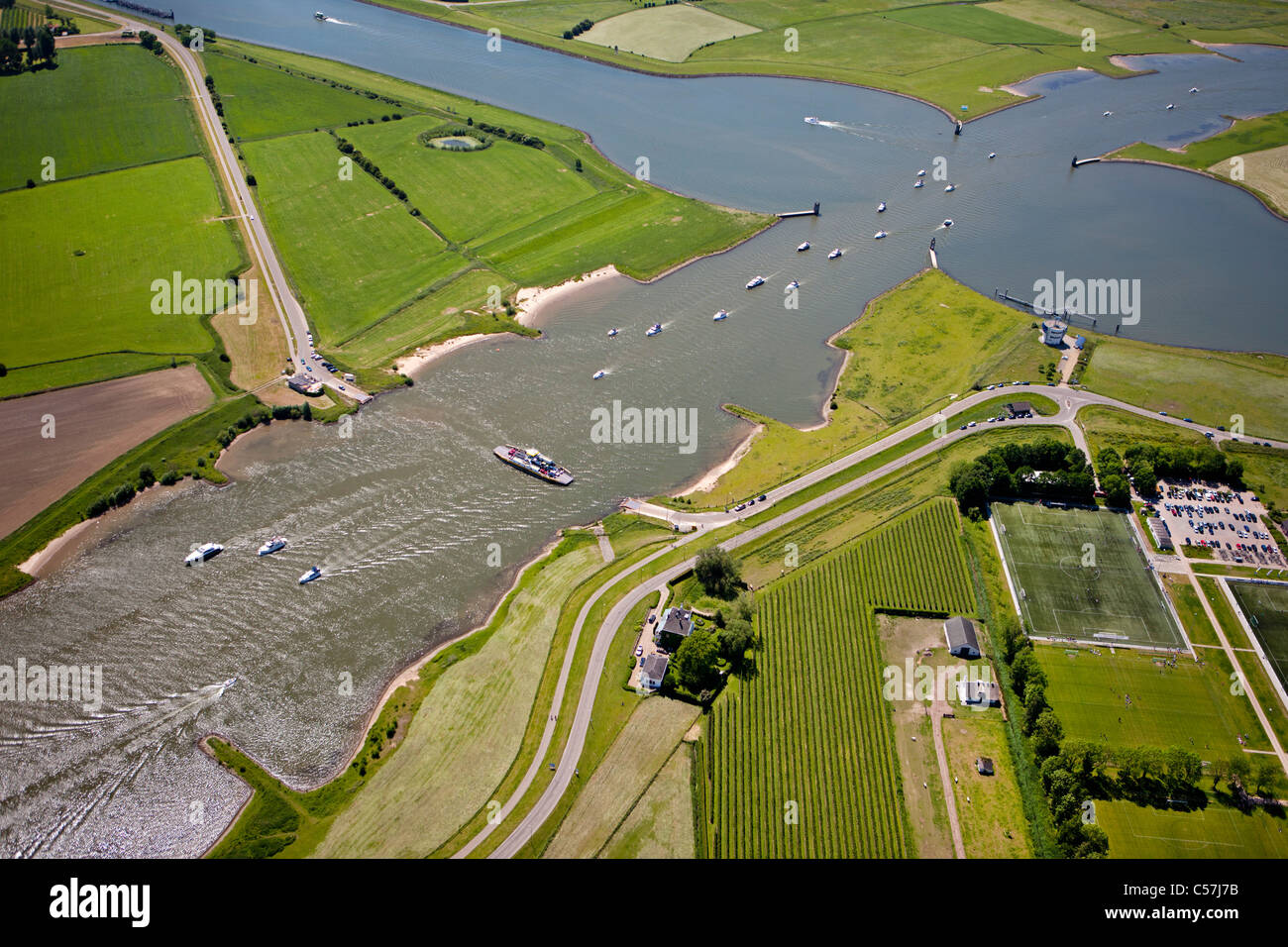 The Netherlands, Wijk bij Duurstede, Pleasure boats and yachts. in river called Waal, also called Lek. Aerial. Ferry - Stock Image