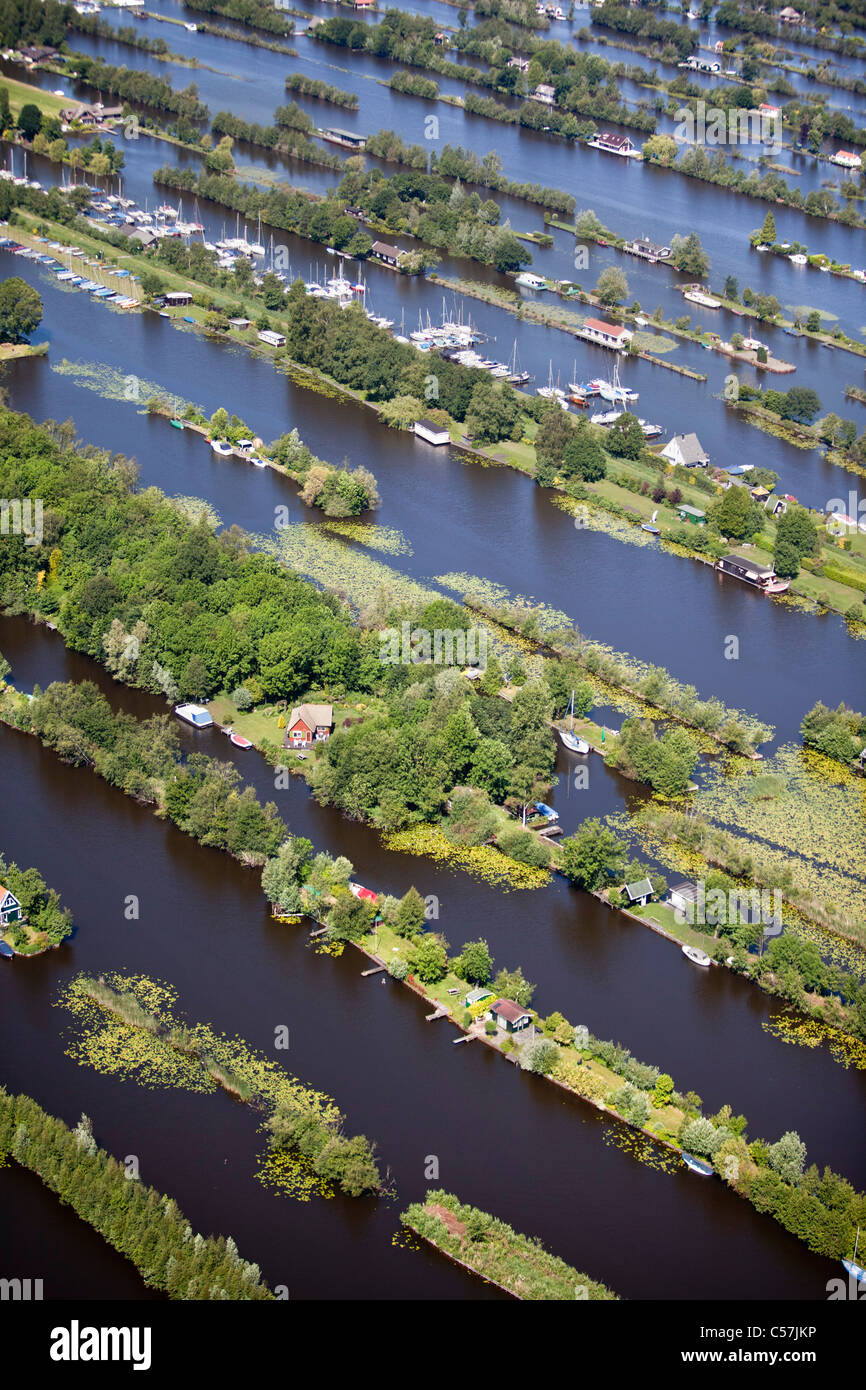 The Netherlands, Breukelen, Dugged out land in marsh. Aquatic sports. Housing holiday houses. Aerial. - Stock Image