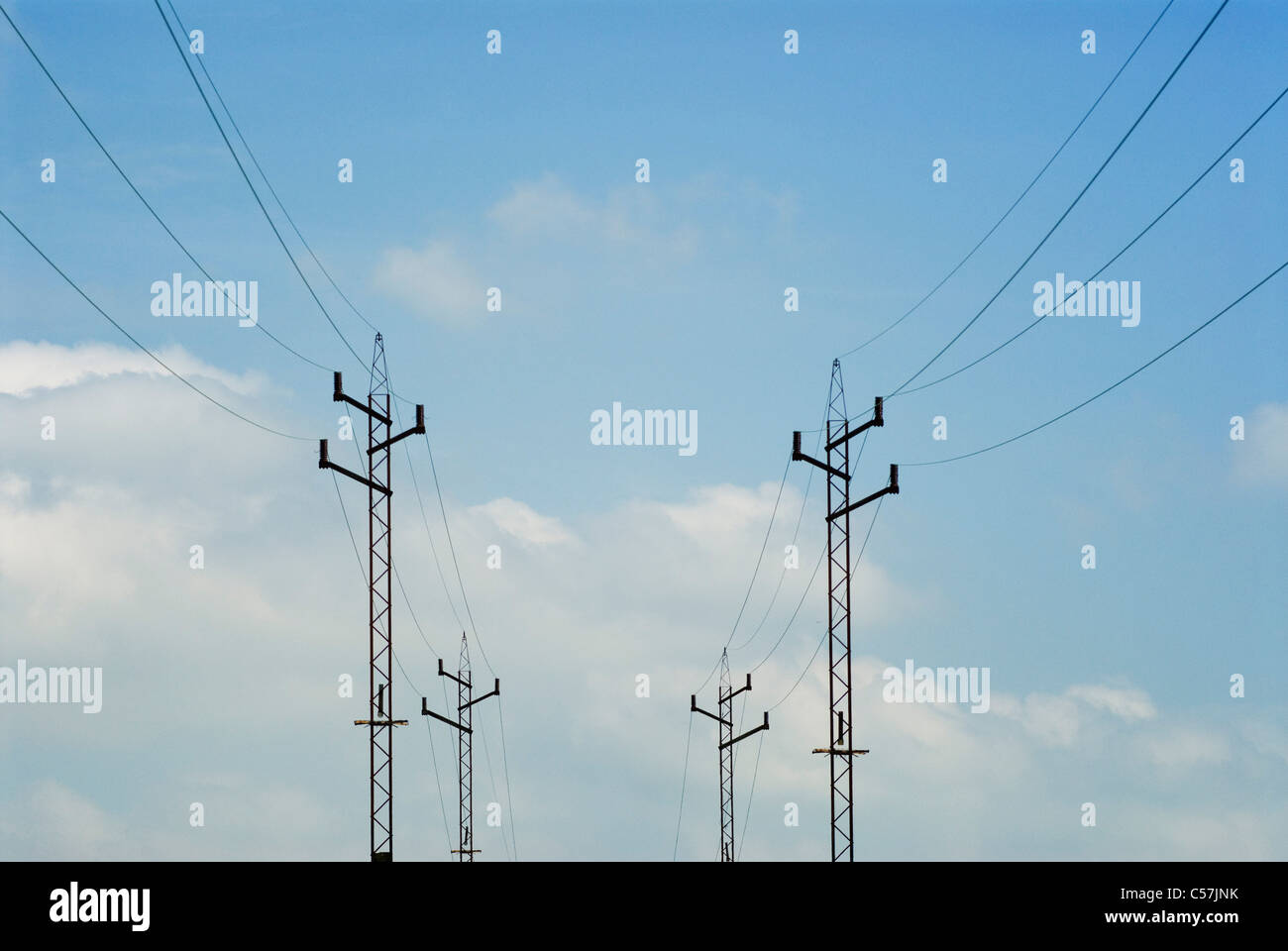 Power lines against blue sky - Stock Image