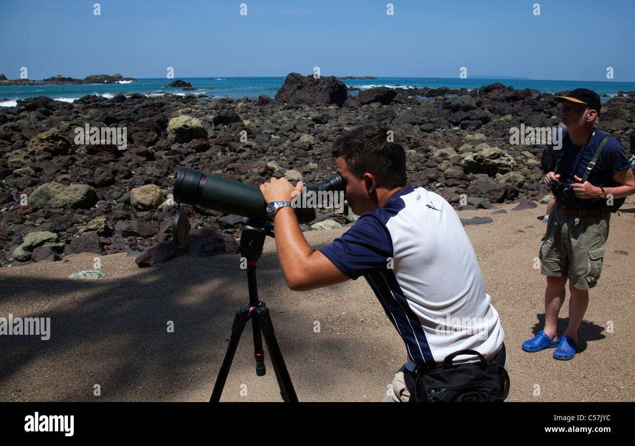 Ecotourism ecotourists with spotting scope - Stock Image