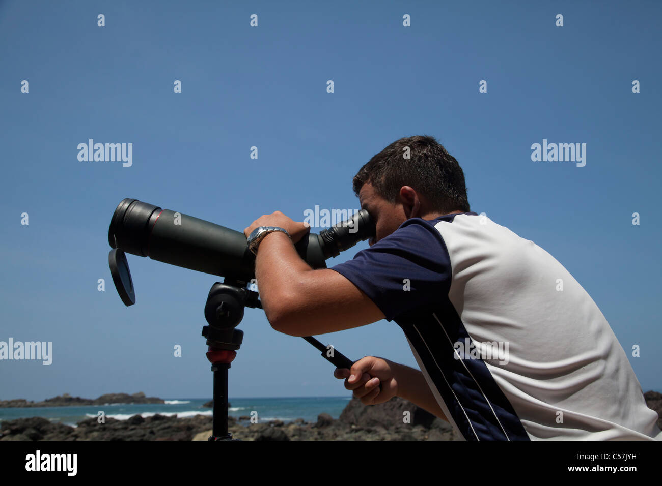 Ecotourism ecotourist with spotting scope - Stock Image