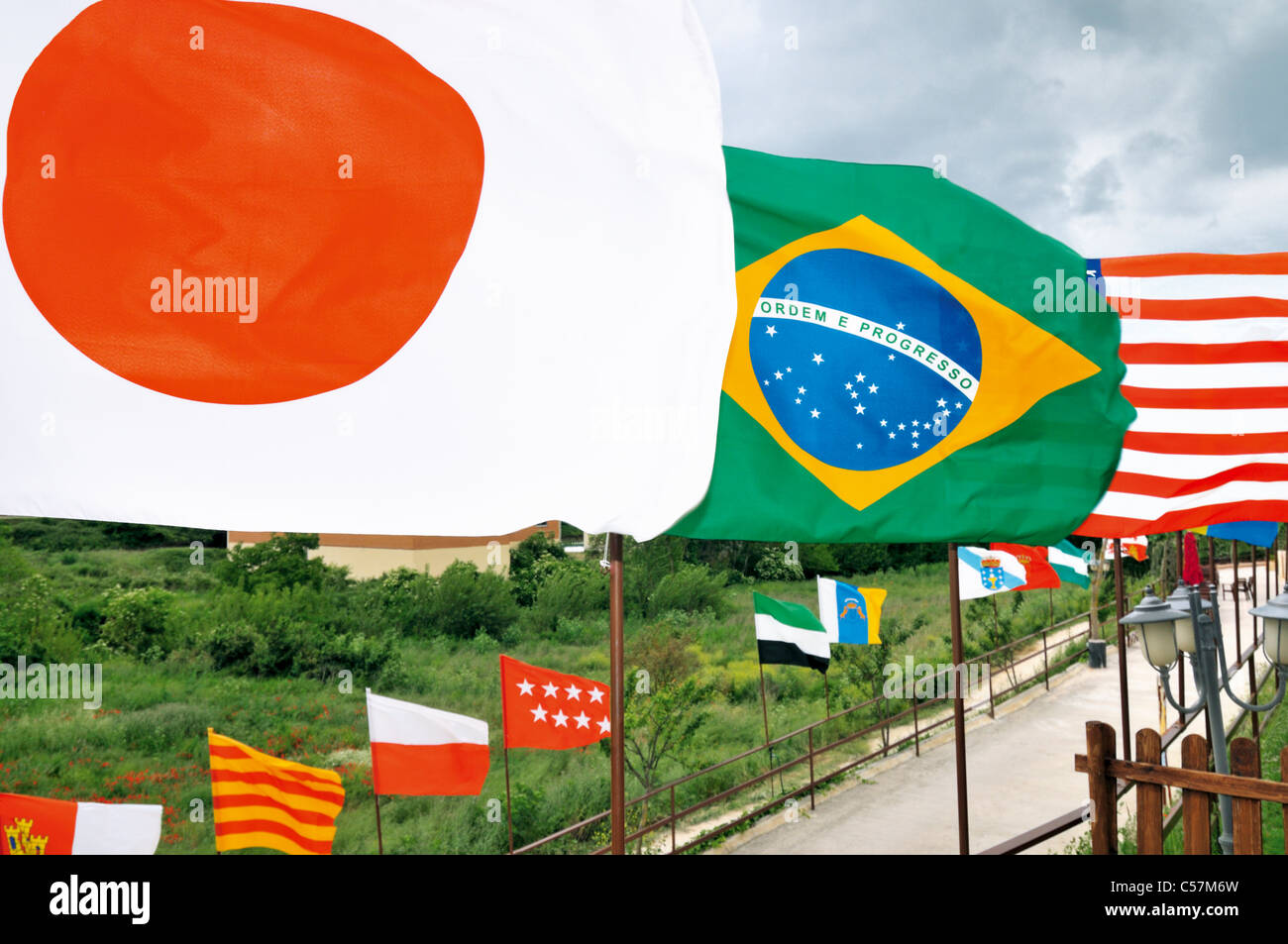 Spain, St. James Way: Nation flags at the pilgrims hostel 'Albergue A Santiago' in Belorado - Stock Image
