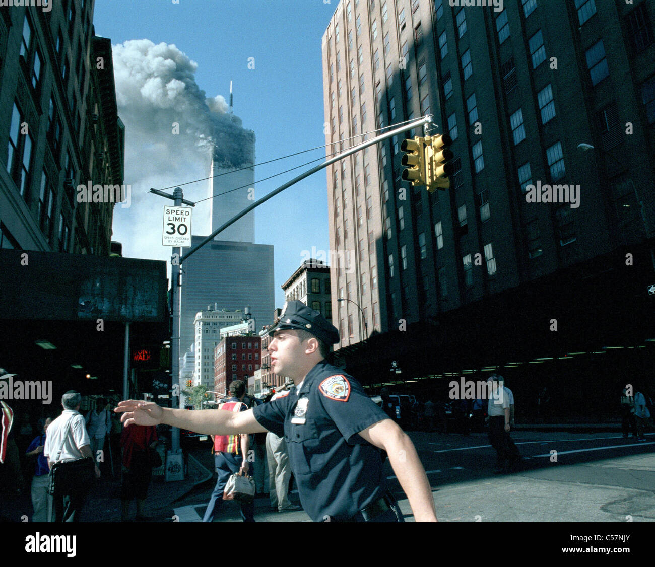 World Trade Center fire/ terrorism September 11, 2001. Police officer directs traffic. (© Frances M. Roberts) - Stock Image