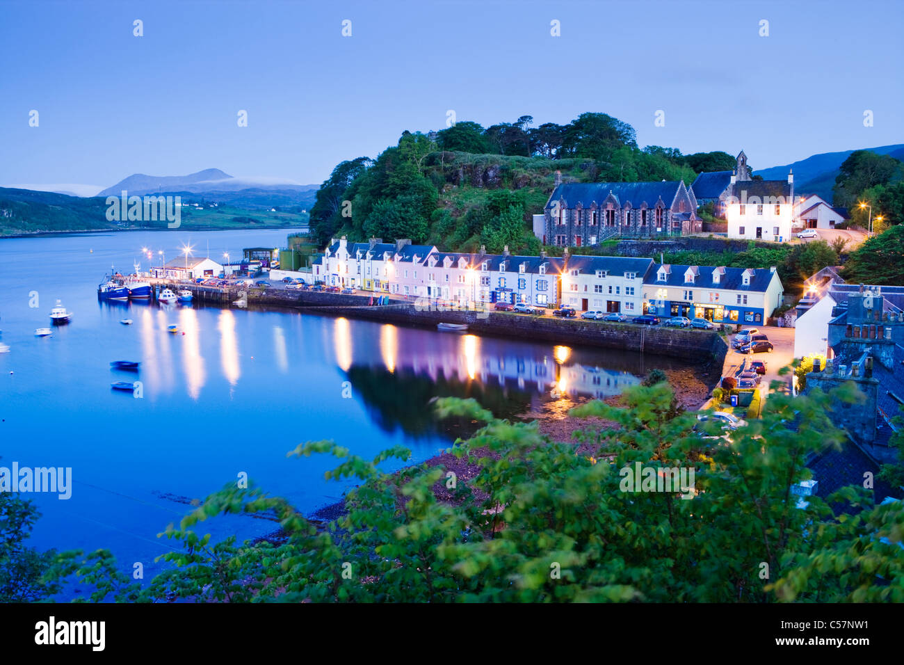 Portree, Isle of Skye, Scotland, UK. Red Cuillins (Glamaig) in distance. - Stock Image