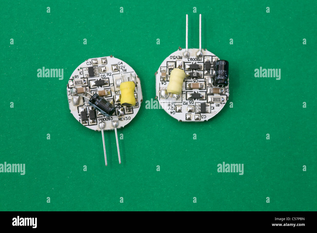 Close up reverse side of two low power usage 12 volt side fitting LED lights showing the resistors and circuituary Stock Photo