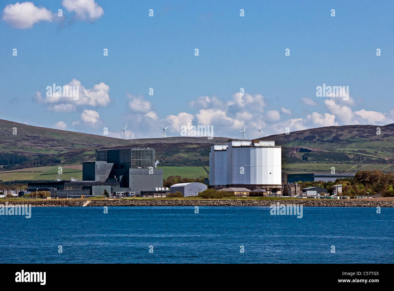 Hunterston nuclear power station at Hunterston Ayrshire Scotland as seen from the Firth of Clyde side with wind - Stock Image