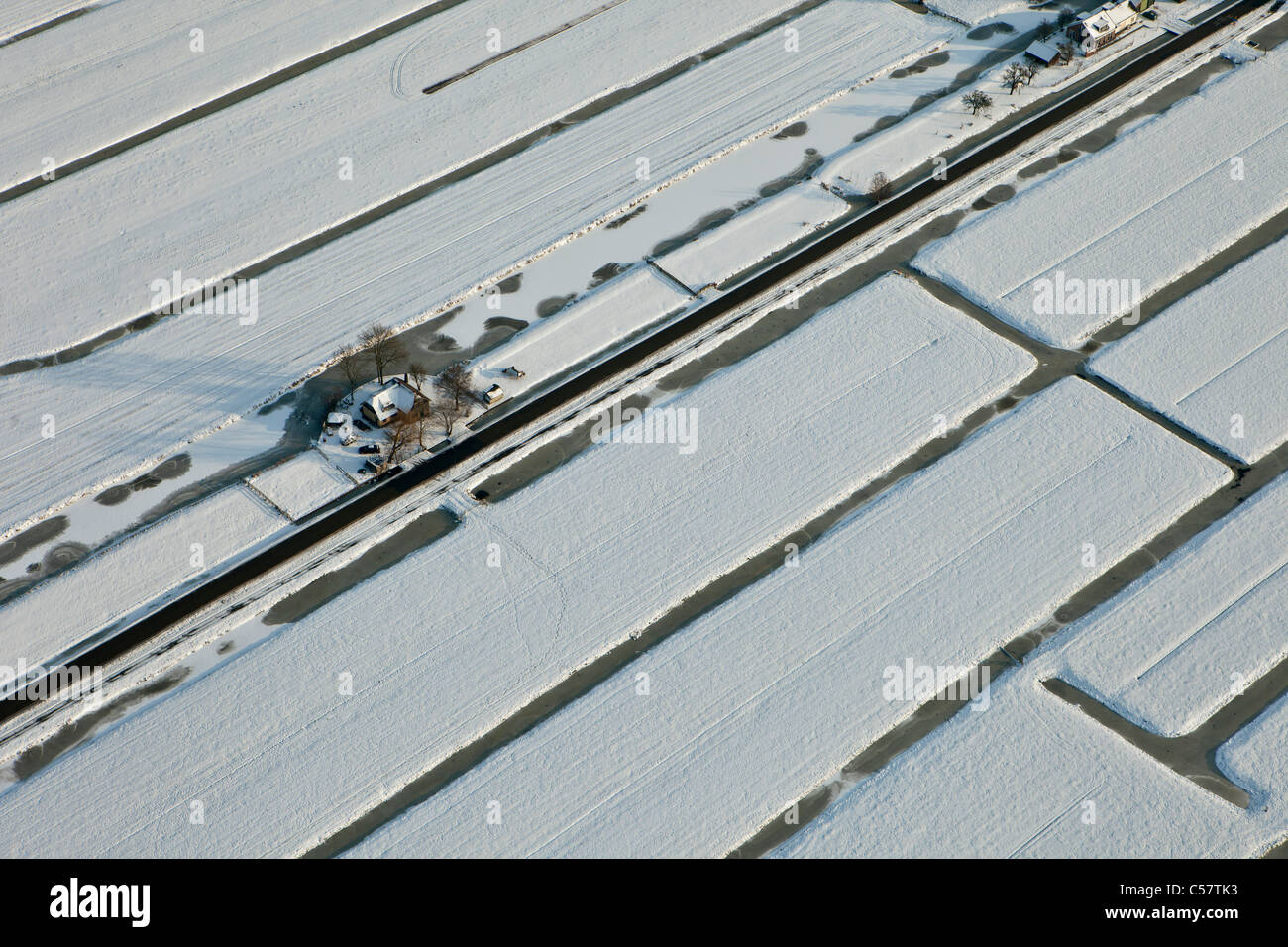 The Netherlands, near Schoonhoven, farm in snow. Aerial. - Stock Image