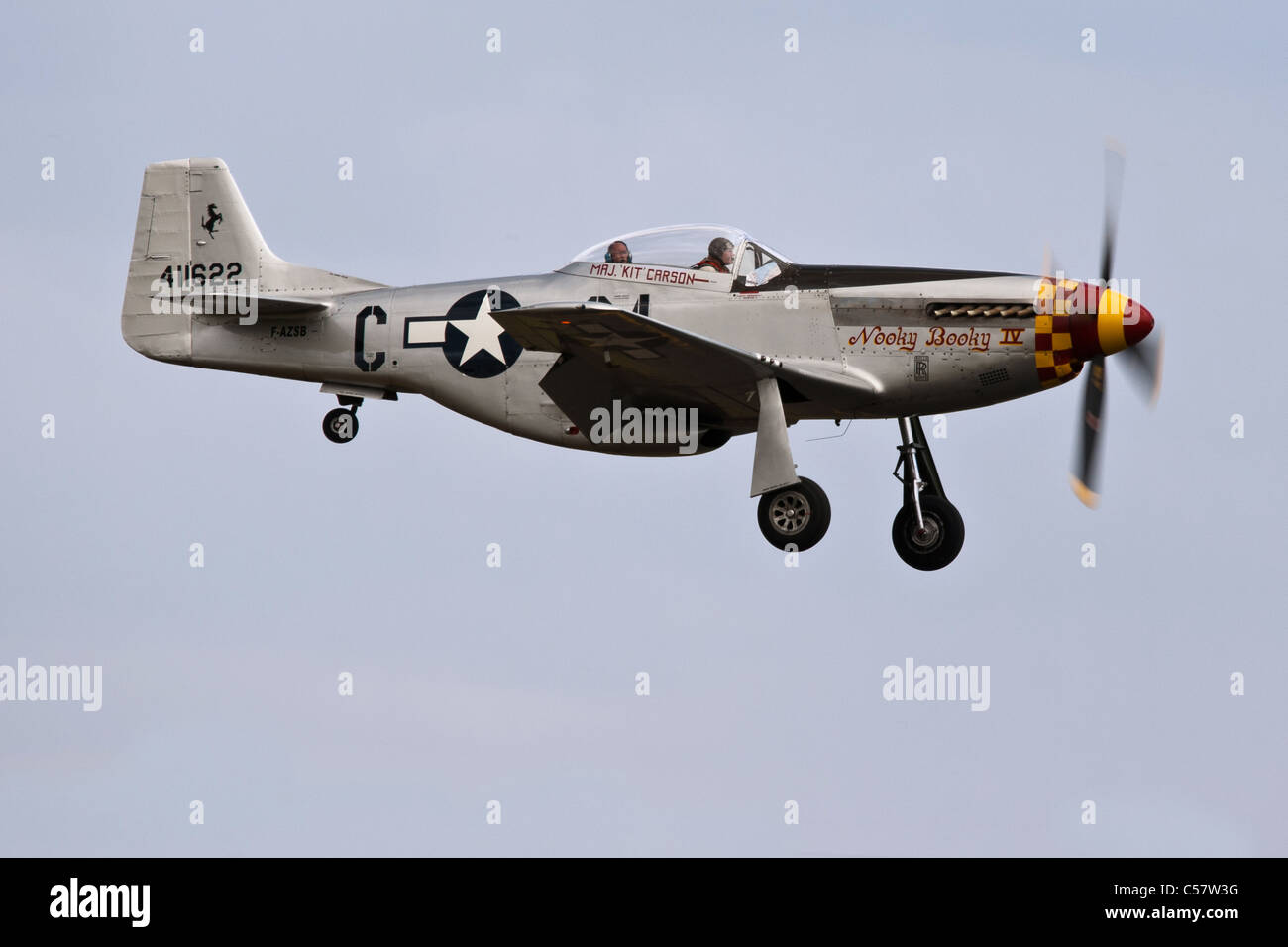 North American P-51D Mustang Nooky Booky IV about to land at the IWM Duxford - Stock Image