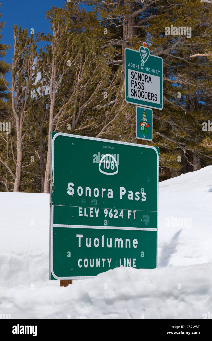 Sonora Pass sign buried and covered in snow California USA - Stock Image