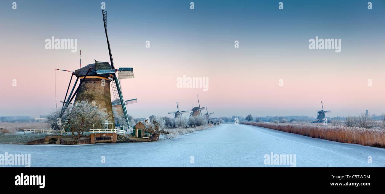 The Netherlands, Kinderdijk, Windmills, Unesco World Heritage Site. Winter. Panoramic view. - Stock Image