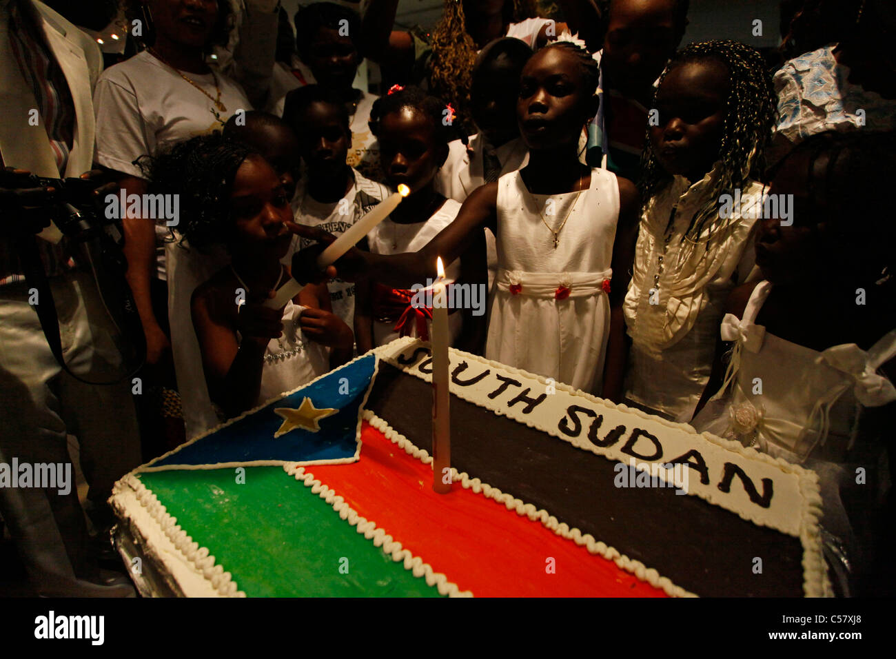 South Sudanese children celebrate with a Republic of South Sudan flag cake  during independence celebrations