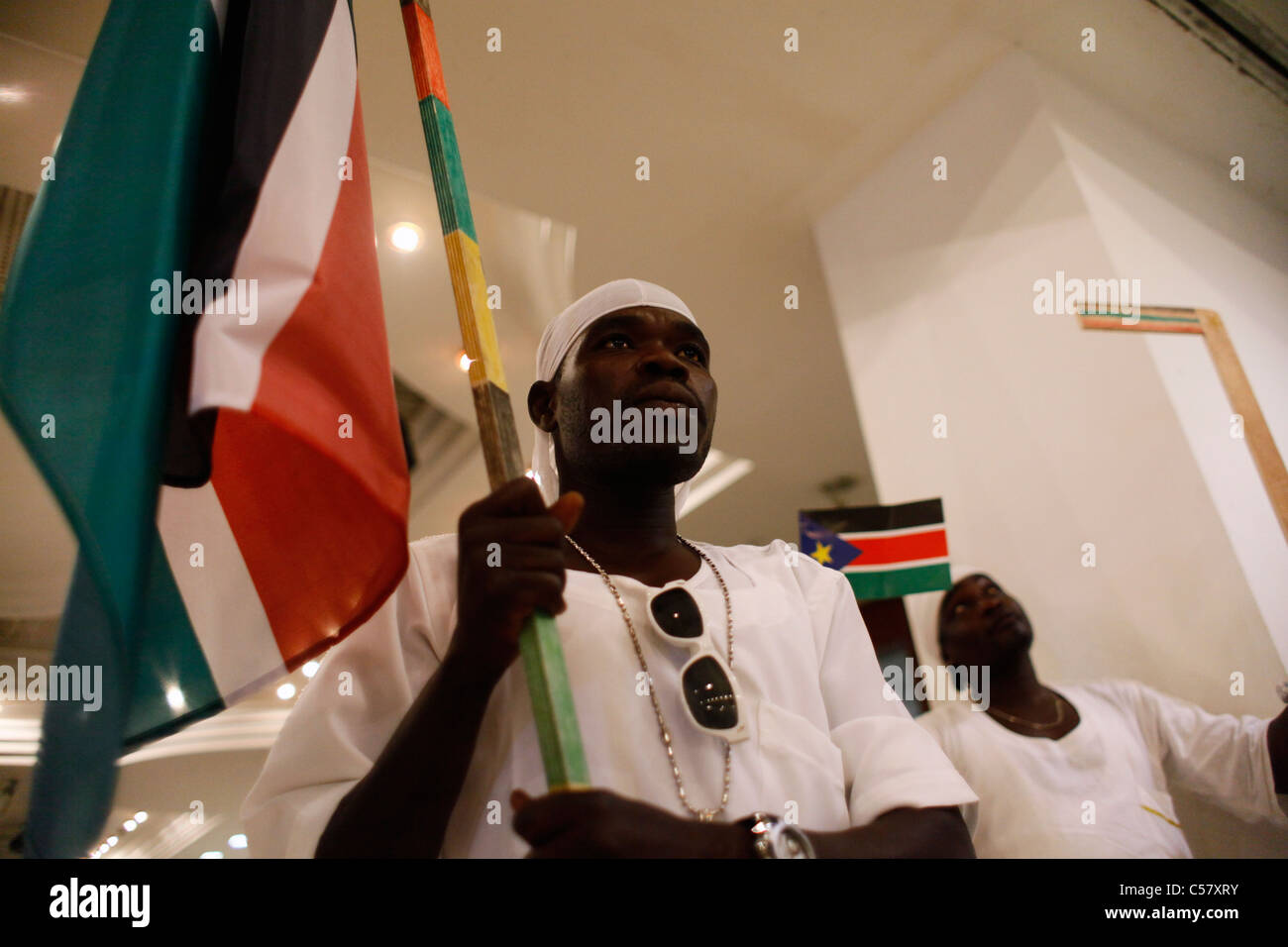 South Sudanese man holds the flag of Republic of South Sudan during independence celebrations - Stock Image