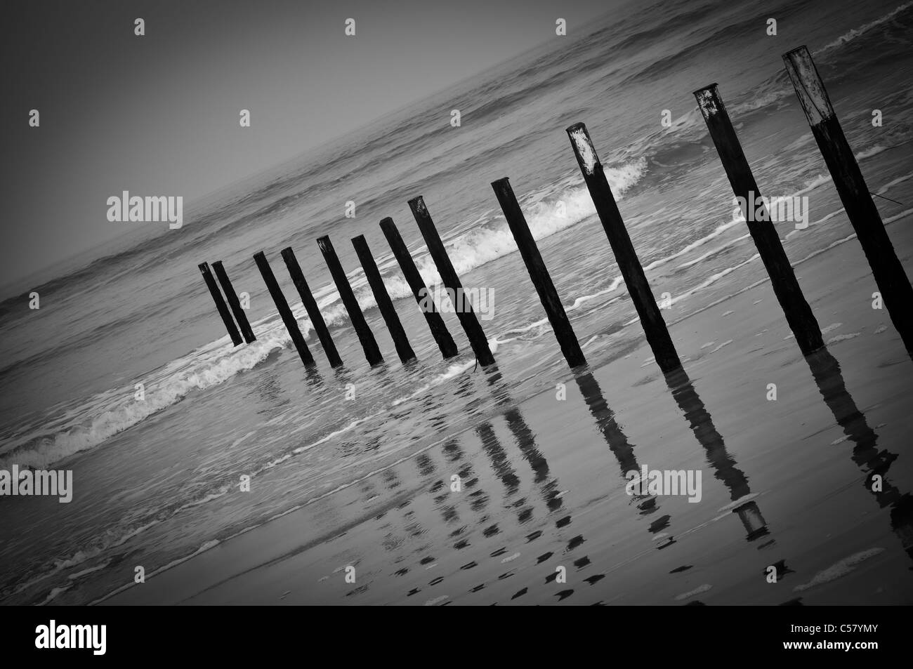 Breakwater beach posts in Port Stewart, Northern Ireland - Stock Image