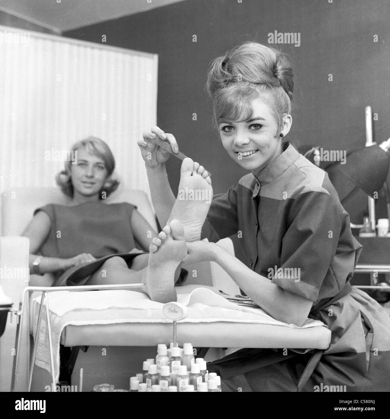 Janice Nicholls working as a chiropodist after appearing on the 1960s TV show Thank Your Lucky Stars - Stock Image