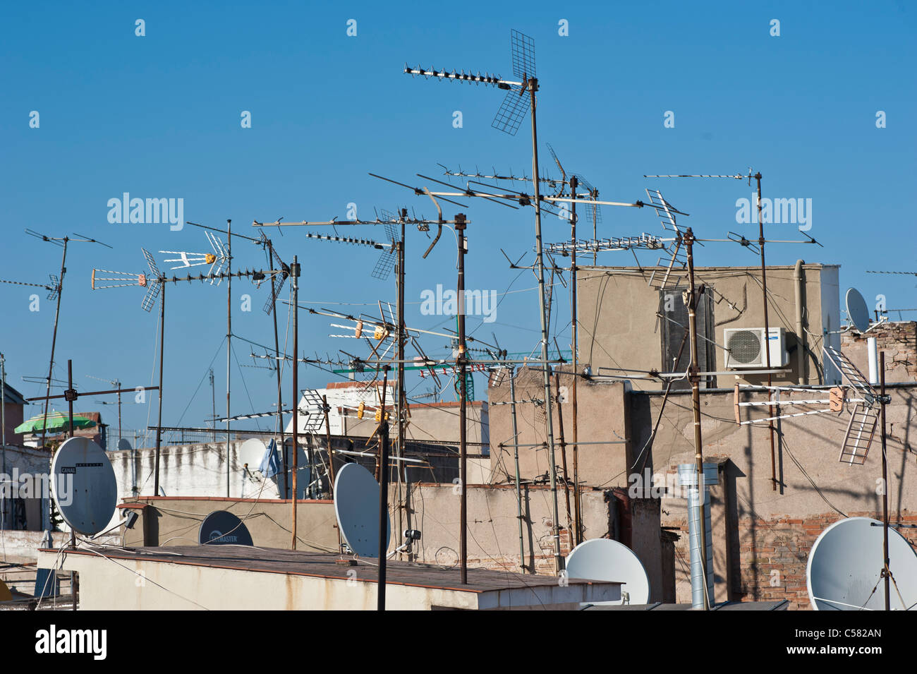 Tv aerials in the old part of the city of Barcelona, Spain - Stock Image