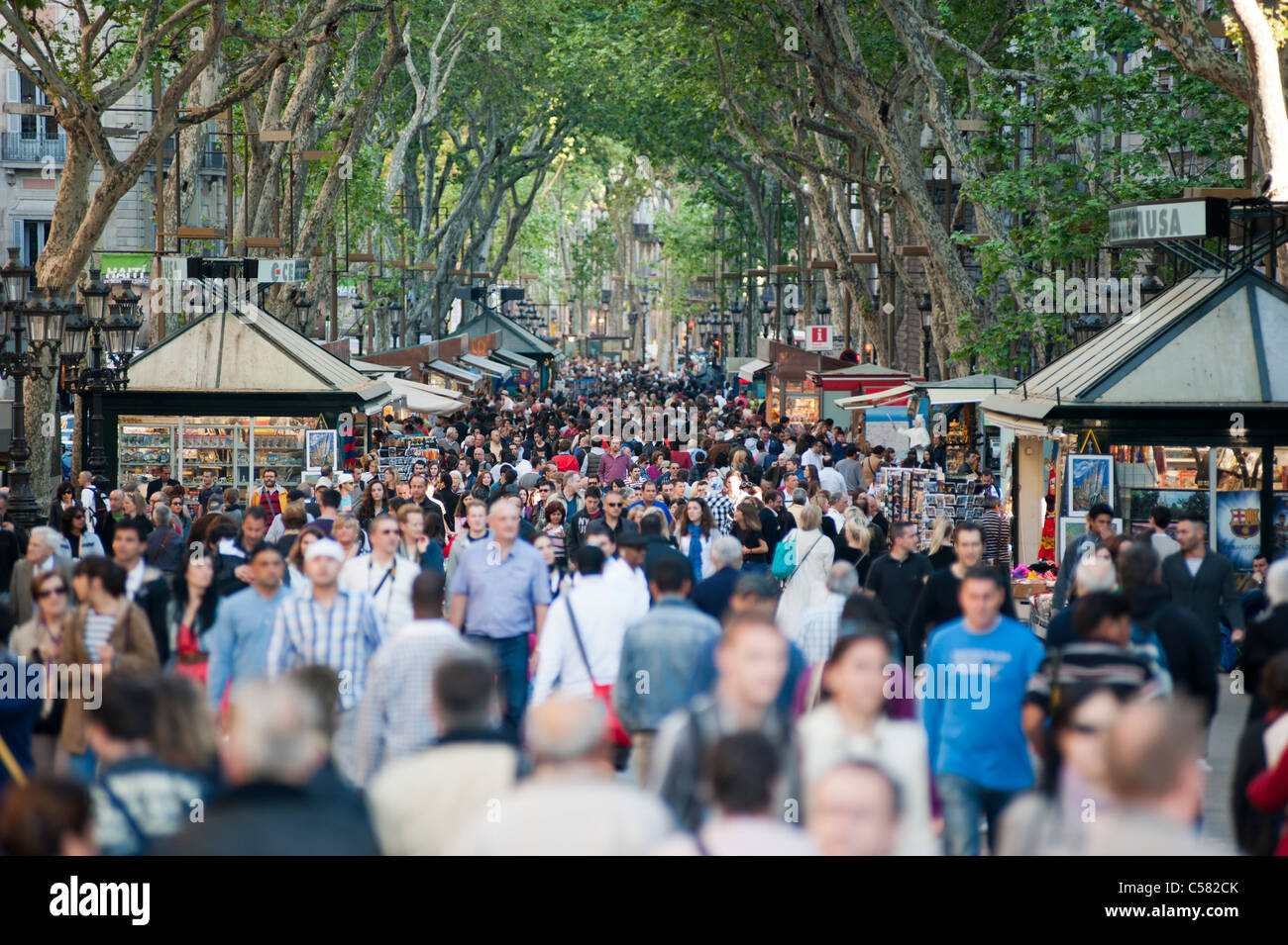 View of Las Ramblas of Barcelona crowded with people, Spain - Stock Image