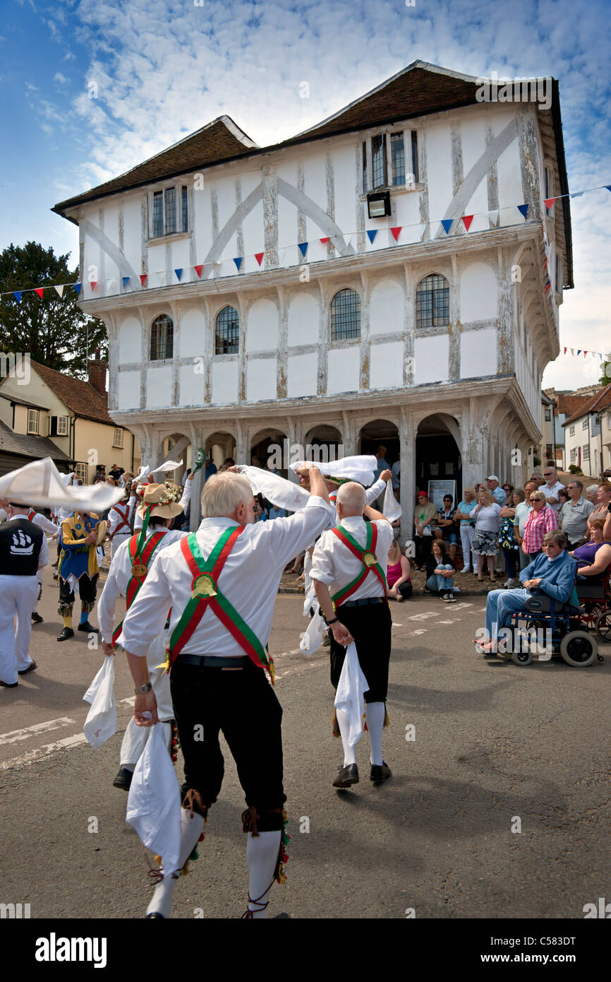 Morris Dancing at the Centenary Morris Dancing Festival in Thaxted, Essex, England, in 2011, in front of the ancient - Stock Image