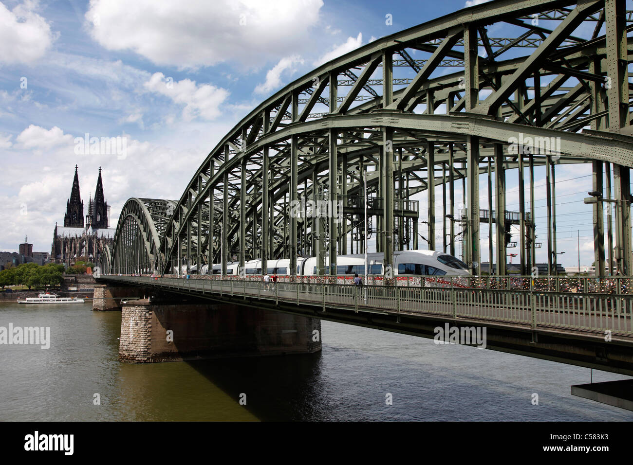Skyline of Cologne, Germany. River Rhine, Hohenzollern railway bridge, Cologne cathedral. - Stock Image