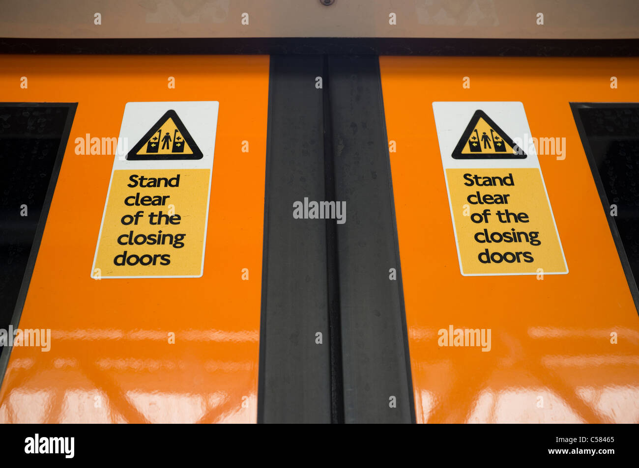 Stand Clear of the Closing Doors Signs on London Overground Train Doors & Stand Clear of the Closing Doors Signs on London Overground Train ...