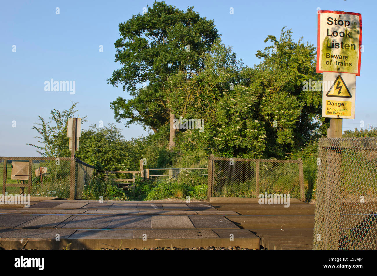 Level crossing over train line Amberley West Sussex England  Uk - Stock Image