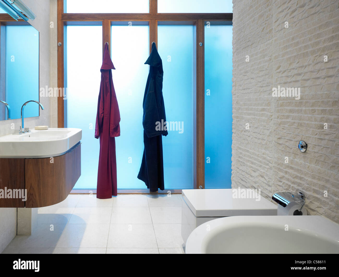 Two bath robes hanging in a modern bathroom Stock Photo: 37674365 ...