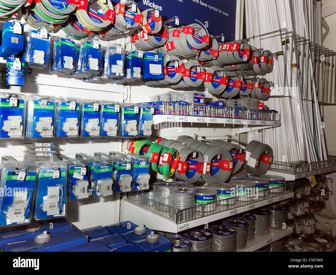 Electrical Fittings On Shelves In D.I.Y Store Circuit Breakers; Cables And Trunking - Stock Image
