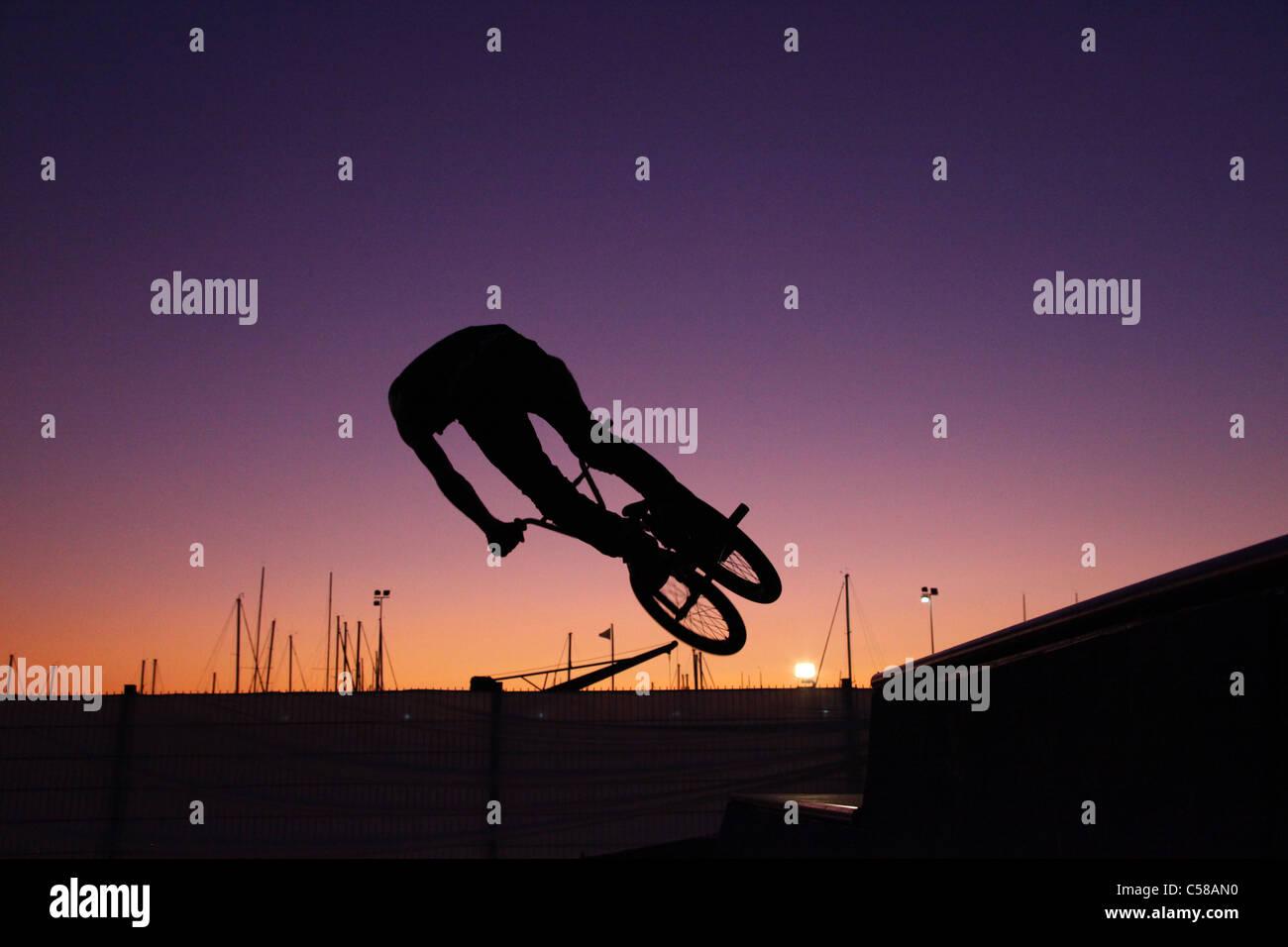 BMX jump, sunset, bicycle - Stock Image