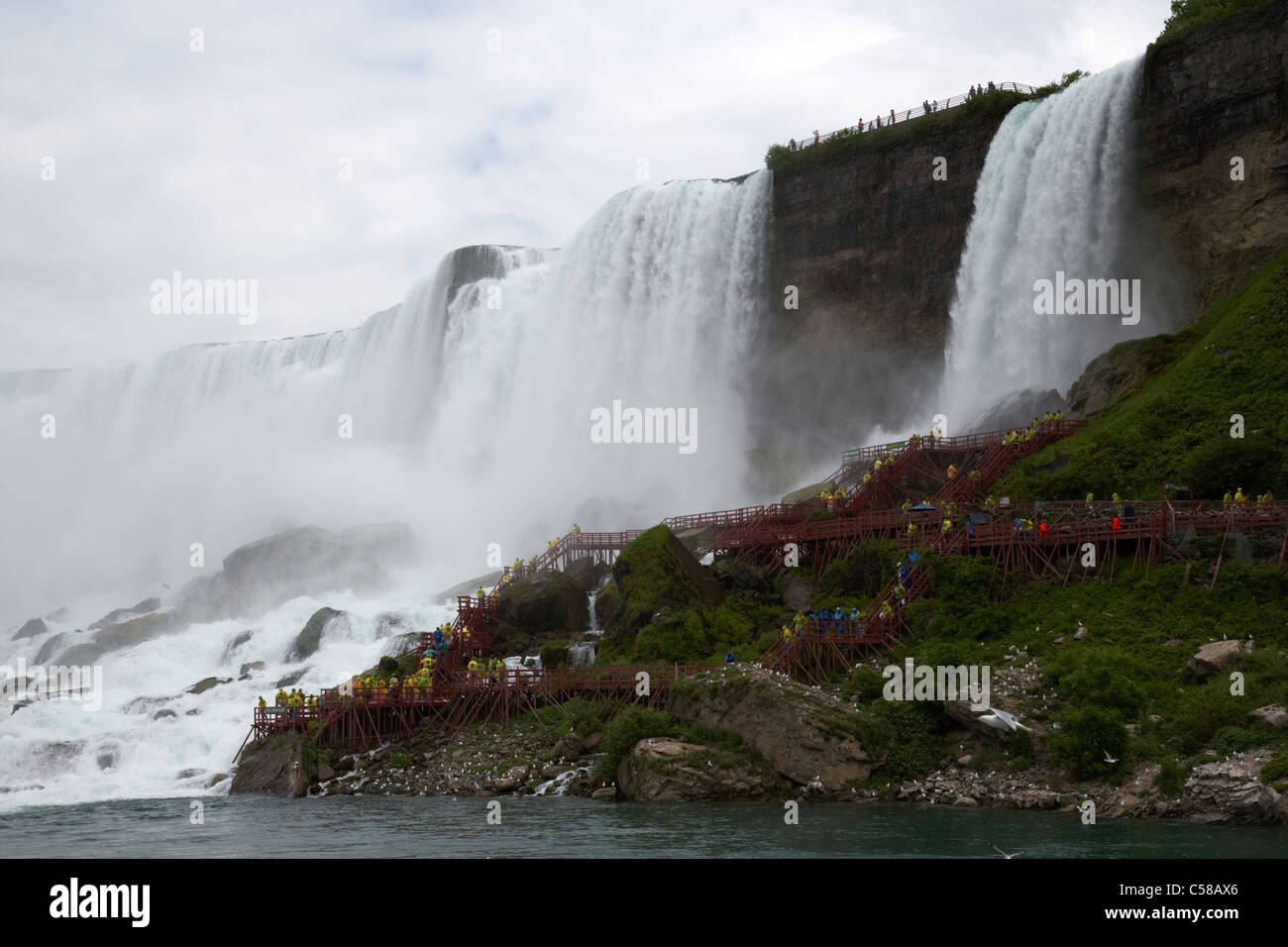 american and bridal veil falls with cave of the winds walkway niagara falls new york state usa - Stock Image