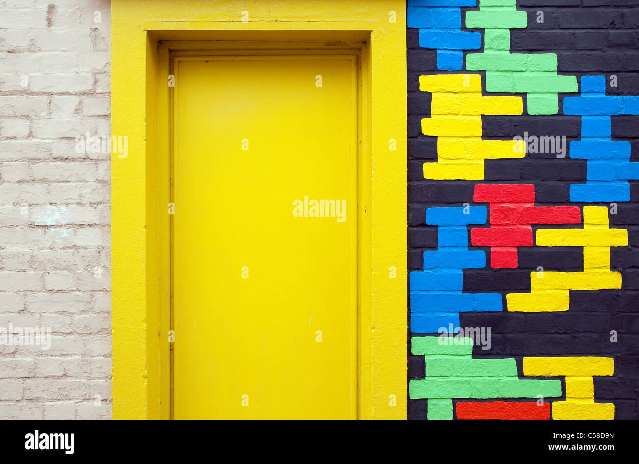 yellow door with colourful pattern brick wall Stock Photo: 37680097 ...