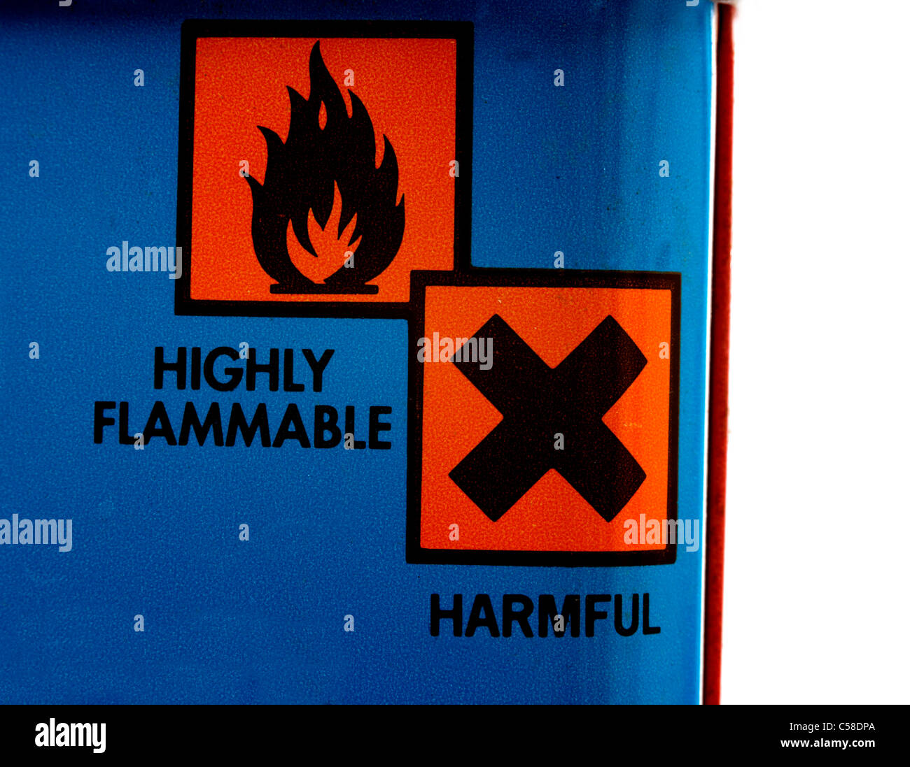 Highly Flammable And Harmful Warning Symbols On Lighter Fluid - Stock Image