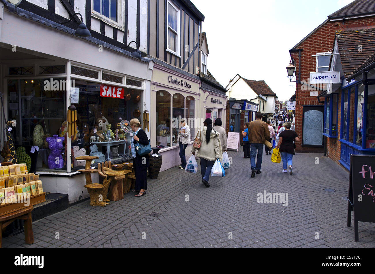 narrow pedestrian lane with small shops in the centre of Colchester - Stock Image
