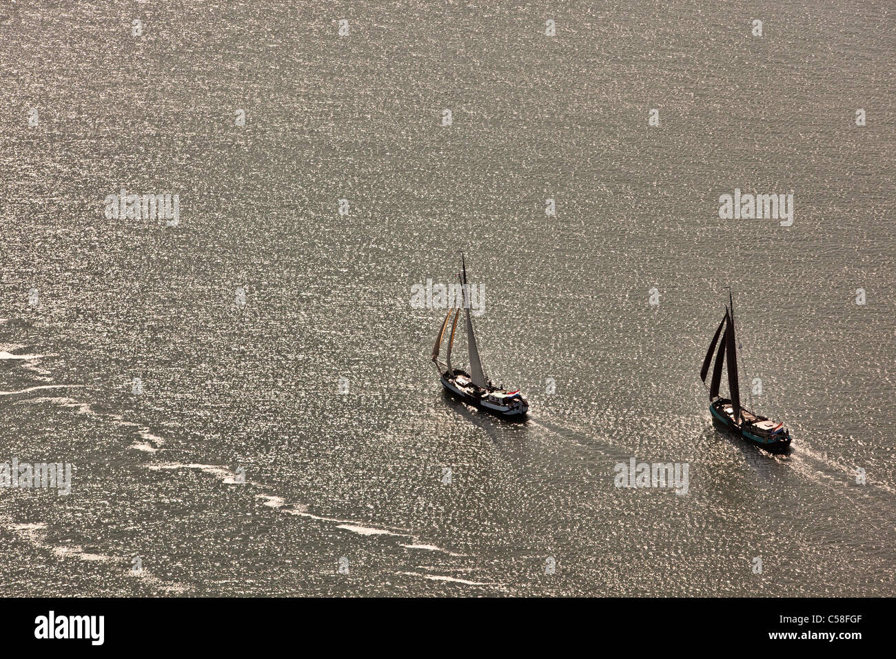 Holland, Island Terschelling, Wadden Sea. Unesco World Heritage Site. Aerial. Traditional cargo sailing ships, tourist - Stock Image