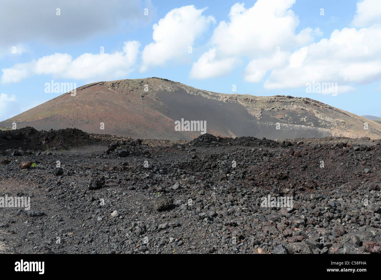 Spain, Lanzarote, Montana Colorada, lava bombs, lava field, mountains, scenery, rock, cliff, spectacle of nature, - Stock Image