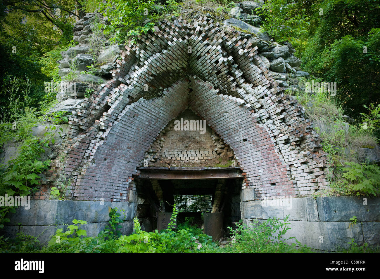 Ruins of blast furnace at Copake Iron Works, Taconic State Park, Columbia County, New York State - Stock Image