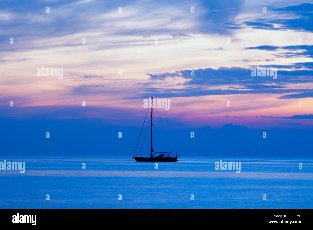 Adriatic, adventure, anchored, boat, clouds, Croatia, dusk, horizon, journey, leisure, nature, nautical, reflection, - Stock Image