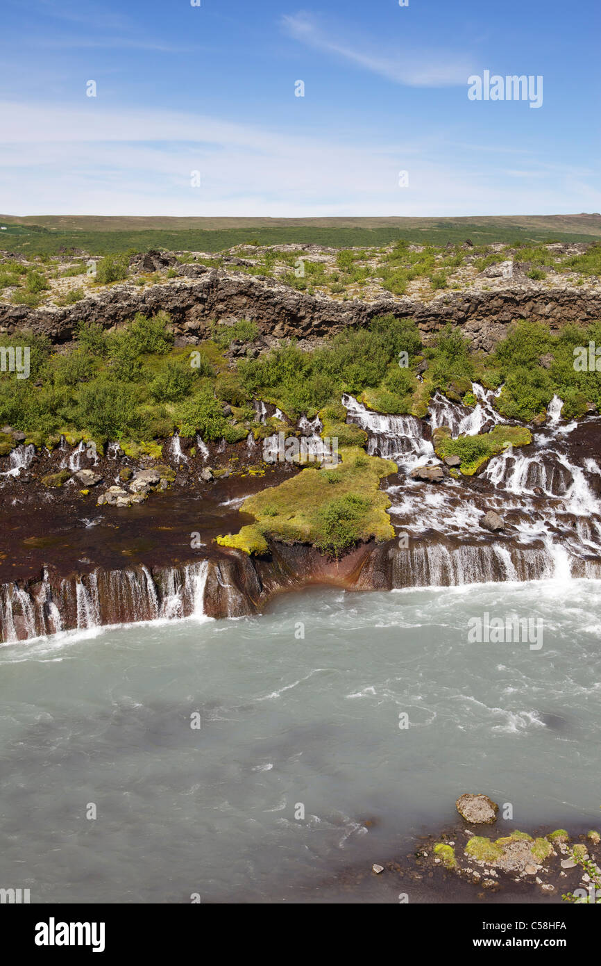 Hraunfossar or Lava Falls, near Husafell Iceland. These beautiful falls come from underneath the nearby lava field - Stock Image
