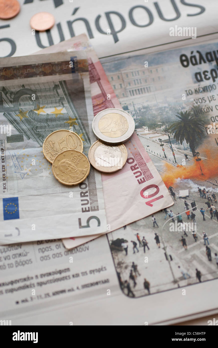 greece,crisis,protesters,money,financial,bankrupt,coins,newspaper,news - Stock Image