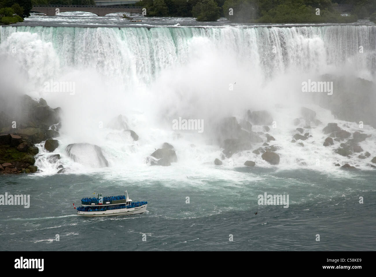 maid of the mist boat below the american and bridal veil falls niagara falls ontario canada - Stock Image