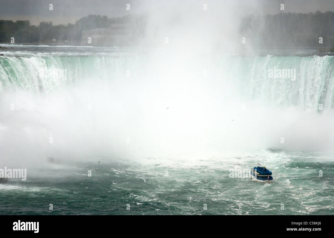 maid of the mist boat on the niagara river approaching niagara horsehoe falls ontario canada - Stock Image