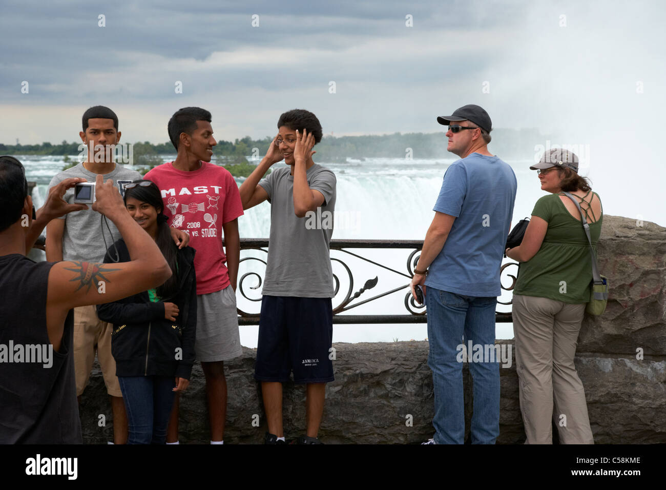 tourists taking photos of the horseshoe falls niagara falls ontario canada - Stock Image