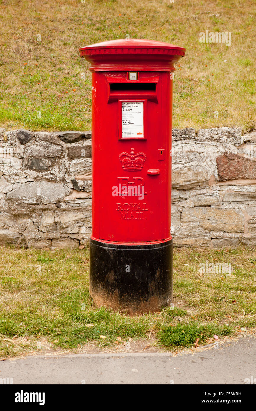 A red UK cast-iron Royal Mail freestanding Pillar Box with an EiiR Royal Cypher. - Stock Image