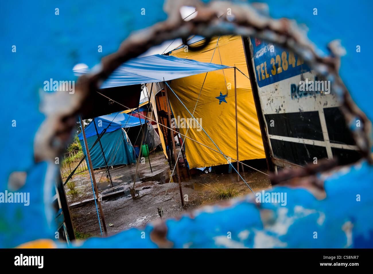 A view through a ticket office showing temporary tents at the Circo Anny, a family run circus wandering Ecuador. - Stock Image