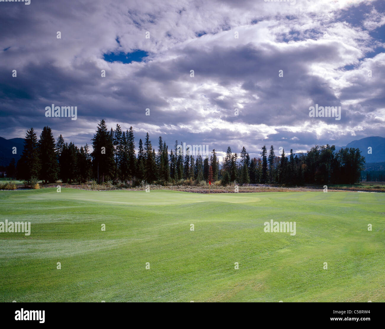 Lush green fairway and green, Riverside Golf Club, Fairmont Hot Springs, British Columbia, Canada. - Stock Image