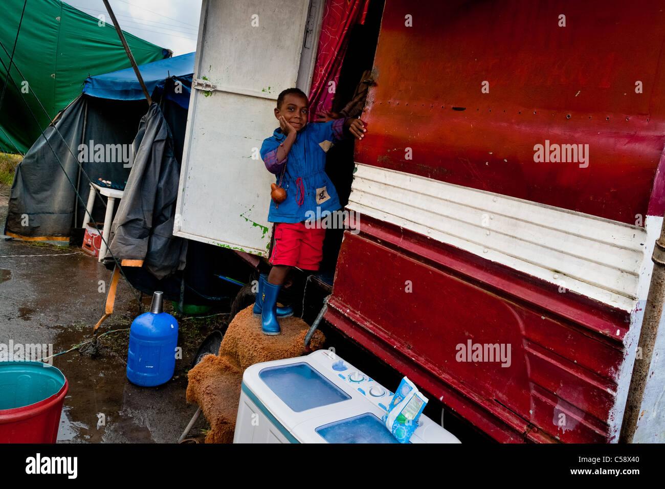A Colombian boy enters his trailer at the Circo Anny, a family run circus wandering the Amazon region of Ecuador. - Stock Image