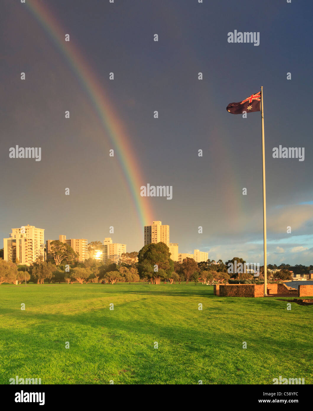 Rainbow over South Perth and Australian flag - Stock Image