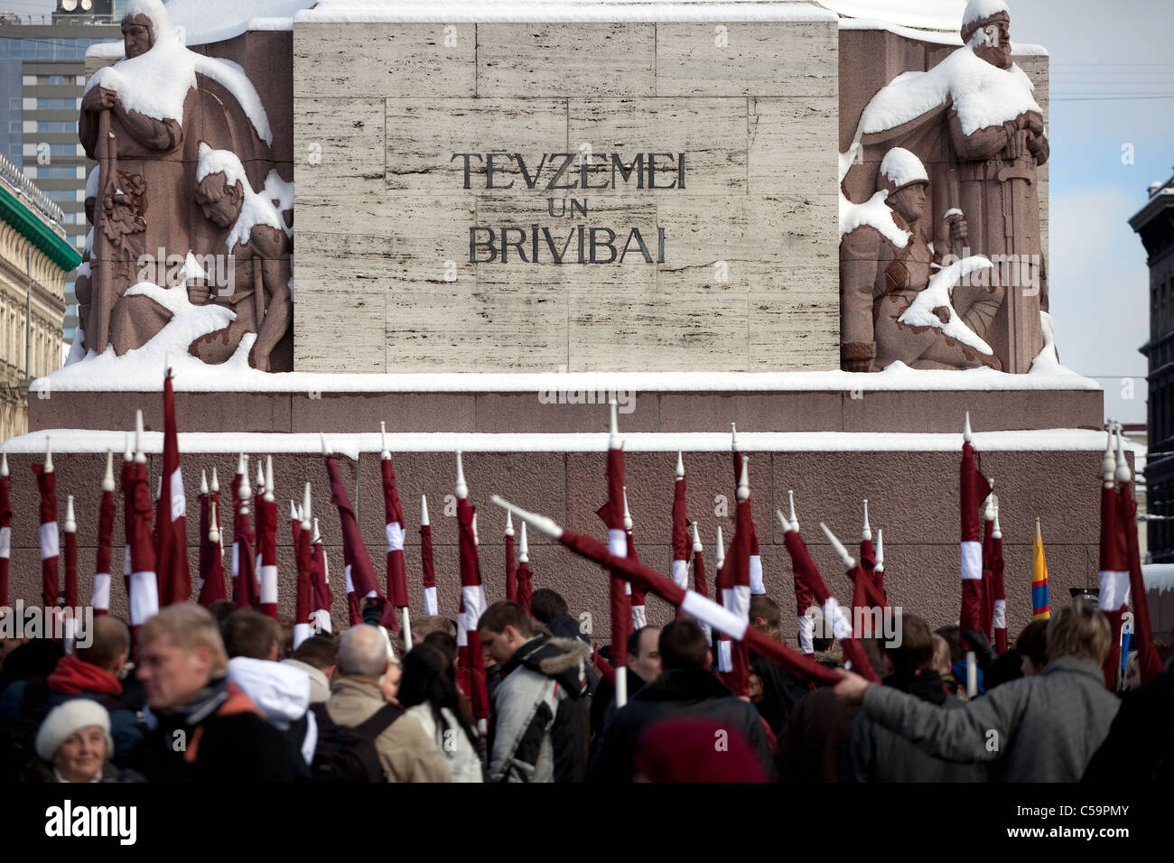 RIGA, LATVIA, MARCH 16, 2010: Latvian flags at Freedom monument. Commemoration of the Latvian Waffen SS unit or Stock Photo
