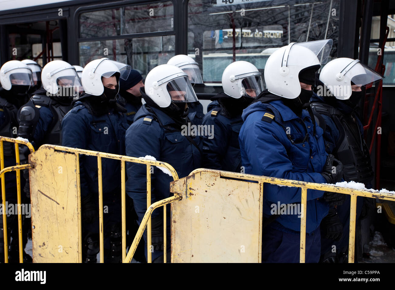 Riot police officers ready to prevent provocations at Commemoration of the Latvian Waffen SS unit or Legionnaires. - Stock Image