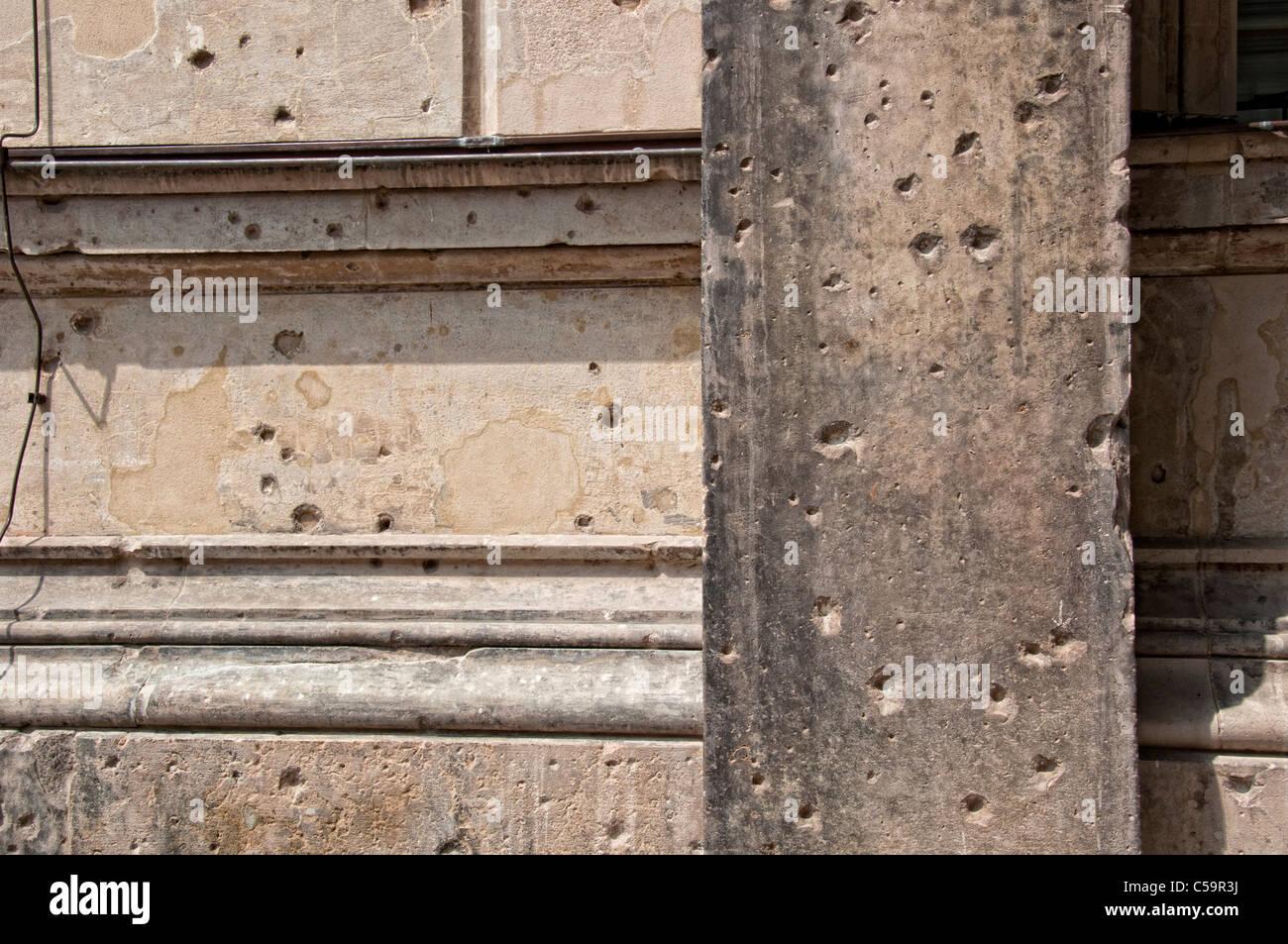 Traces of war at a wall in Berlin; Kriegsspuren an einer Mauer in Berlin - Stock Image