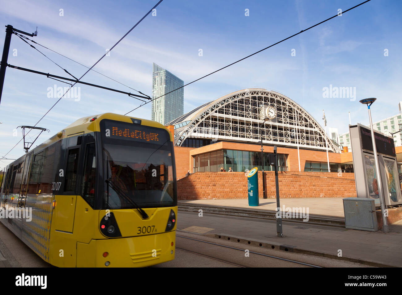 tram passing convention centre, England, Manchester - Stock Image